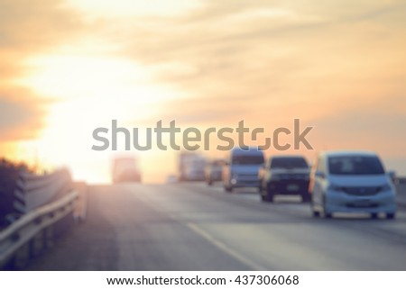 Blurry of rush hour traffic during twilight,motion blur and color toned. - stock photo