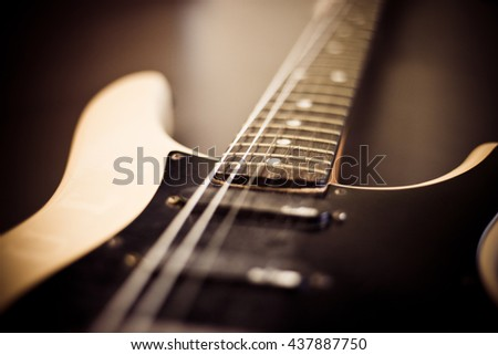 Blurry Old Electronic Guitar with Shallow Depth of Field.