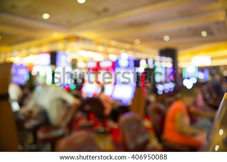 Blurry out of focus players on slot machines in a casino in Las Vegas - stock photo
