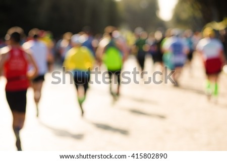 blurry picture of runners in a marathon - stock photo