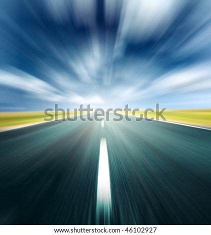 Blurry road and blurry sky with light and clouds - stock photo