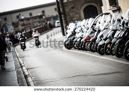 Blurry scooter in florence - stock photo