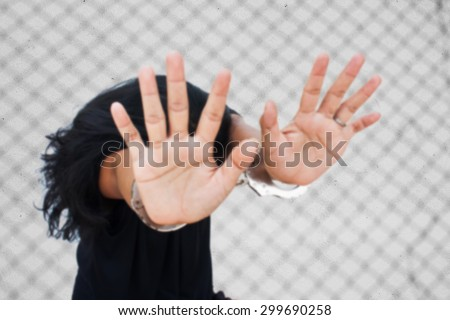 blurry -Slave,Human Trafficking concept,women hand in handcuff  - stock photo