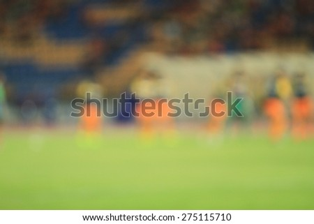 blurry soccer and football player training for background - stock photo