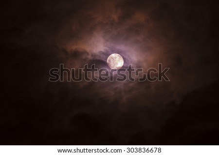 blurry soft and noise dramatic bright moon on cloudy look through window. fancy dream feel