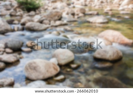 blurry soft flowing water on the rock - stock photo