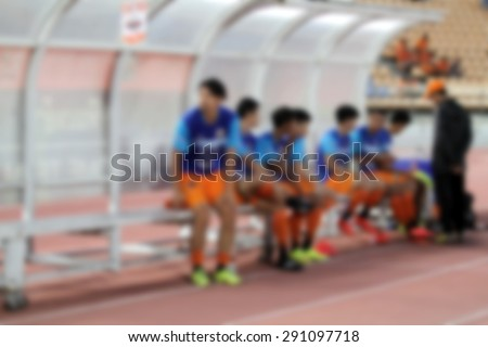 blurry Substitute football players  - stock photo