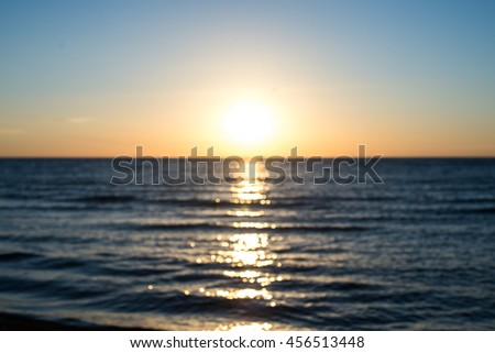 Blurry sunrise above the sea. May be blurry sunset. Excellent bokeh. - stock photo