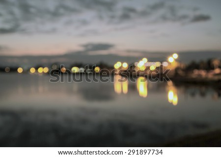 blurry Sunset on the river with beautiful sky - stock photo