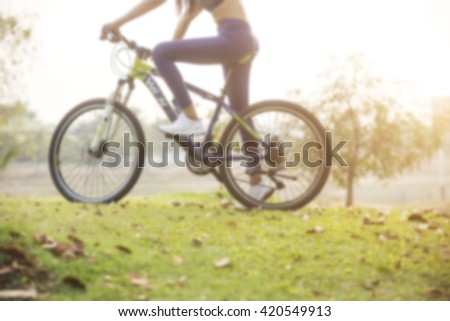blurry Woman cyclist relaxing from the exercise