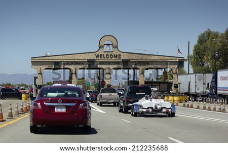 BLYTH, CA - AUGUST 17, 2014: Cars lined up at California Agriculture Control near Arizona-California border crossing on Interstate-10. - stock photo