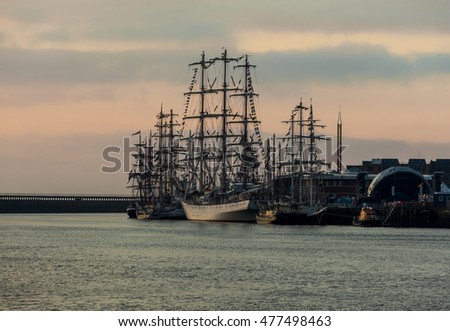 BLYTH, NORTHUMBRLAND, ENGLAND. AUGUST 29, 2016. Tall Ships Regatta. View of ships taken from North Blyth Staithes at sunrise. August 29, 2016. Blyth, Northumberland, England, UK.