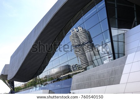 BMW headquarters is reflected in the glass facade of the BMW Welt, Munich, Bavaria, Germany, Europe, 21. May 2014
