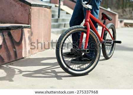 BMX bike rider parked at the skate park. Shallow depth of field. - stock photo