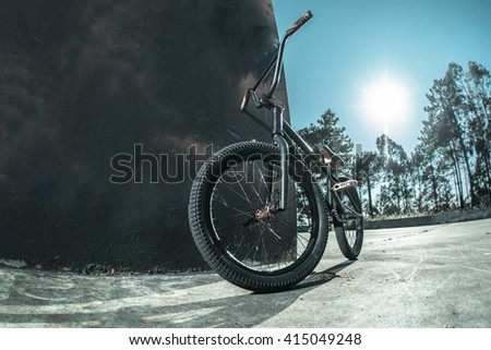 Bmx bike standing against black rough painted wall. - stock photo
