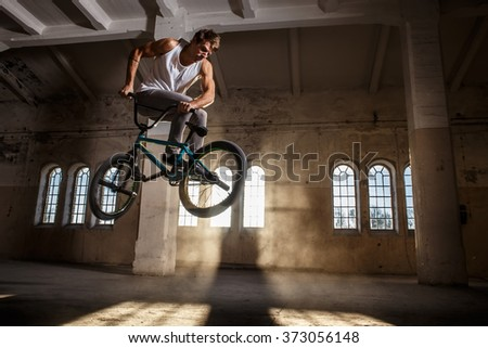 Bmx freestyle. A man jumping with bmx. - stock photo