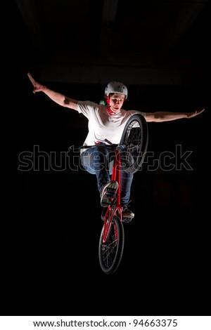 "BMX rider performing air trick ""nohander"" - stock photo"