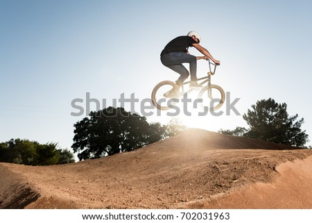 Bmx Table Top on a dirt track.