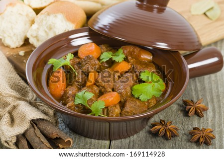 Bo Kho - Vietnamese beef stew cooked with lemongrass, star anise, bay leaf and cassia bark served with crusty bread. - stock photo