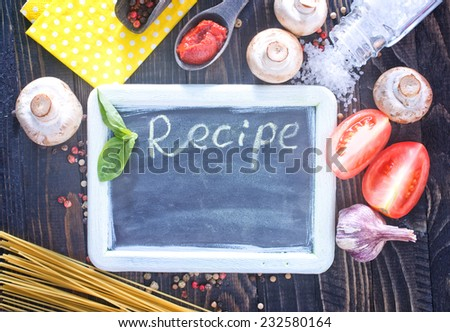 board for recipe and ingredients for pasta - stock photo