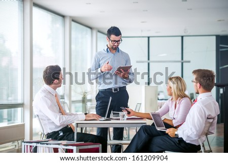 Board meeting in a modern office - stock photo