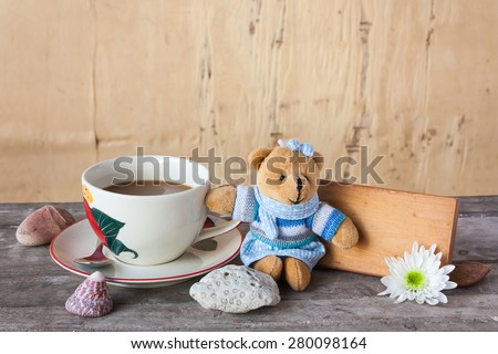 board with coffee and flower on wooden table in vintage tone - stock photo