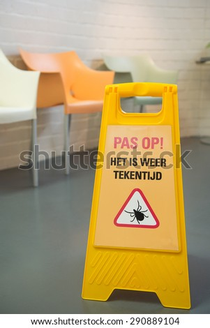 Board with Dutch warning against ticks - stock photo
