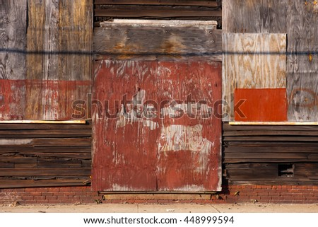 Boarded up abandoned warehouse / factory - stock photo