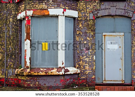 Boarded up houses awaiting regeneration in Liverpool UK. - stock photo