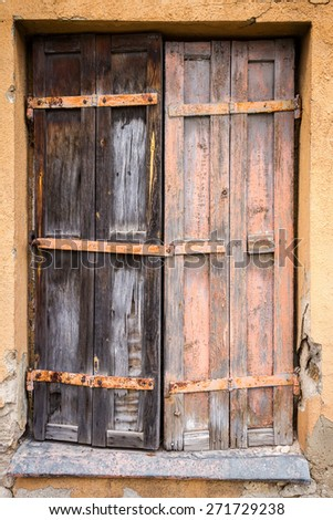 Boarded up window of a abandoned house - stock photo