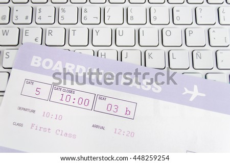 boarding pass on a computer keyboard concept online shopping - stock photo