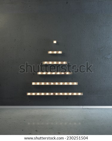 Boards with lightbulb in the form of a Christmas tree on a black wall. Happy new year and Christmas. - stock photo