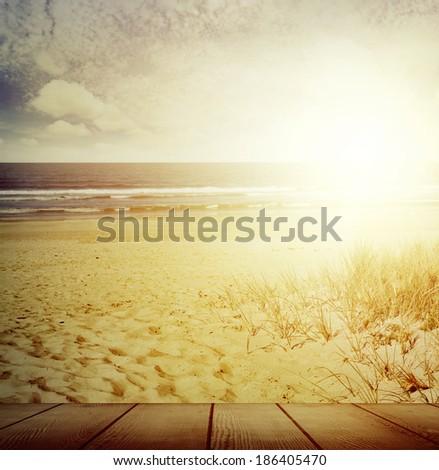 Boardwalk and sunny beach scene - stock photo