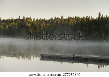 Boardwalk in a lake, Riding Mountain National Park, Manitoba, Canada - stock photo