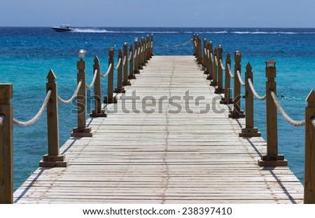 Boardwalk in the caribbean beach - stock photo