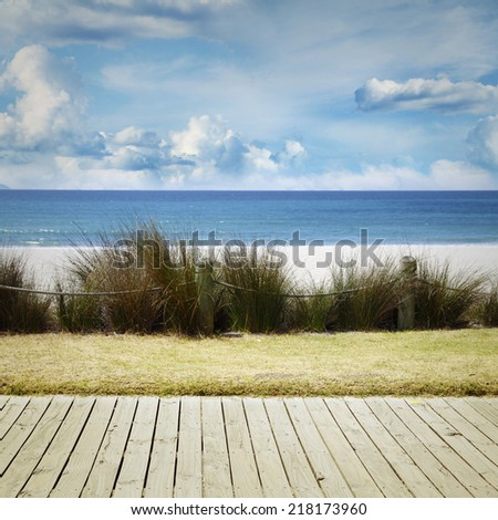 Boardwalk leading to beach scenery - stock photo