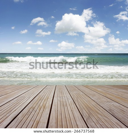 Boardwalk leading to water and sea - stock photo