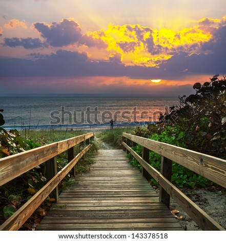 boardwalk on beach - stock photo