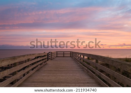 Boardwalk on beach at the crack of dawn (Green Gables Shore, Prince Edward Island, Canada) - stock photo