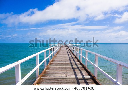Boardwalk out to ocean - stock photo