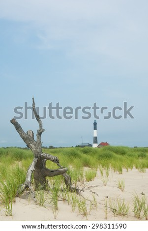 Boardwalk to lighthouse at Fire Island National Seashore, a barrier island off the southern coast of Long Island, New York. A short walk from Robert Moses beach - stock photo
