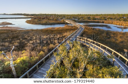 Boardwalk trails cross a tidal outlet to Grand Lagoon in Big Lagoon State Park near Pensacola, Florida - stock photo