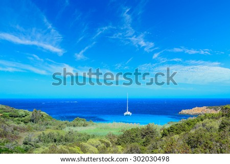 boat alone in Costa Smeralda shoreline, Italy - stock photo