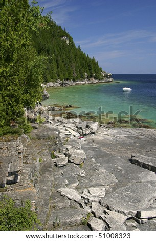 Boat Anchored In Small Great Lakes Inlet - stock photo