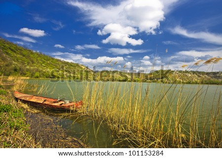 boat and lake composition