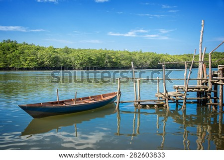 Boat and pontoon on stilts in Indonesia
