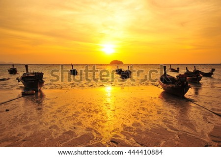 Boat and Sunset at Paradise Beach in Thailand