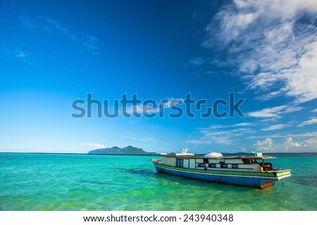 boat ashore with the background being an island