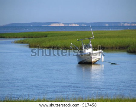 boat at low tide on Cape Cod - stock photo