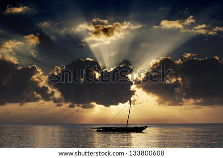 Boat at sea in the glow of the setting sun in Kenya 02 - stock photo
